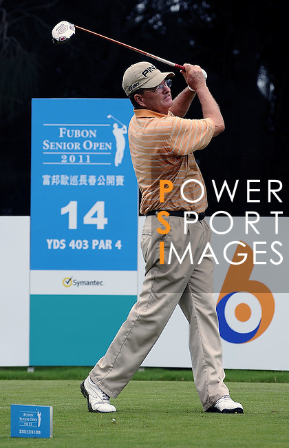 TAIPEI, TAIWAN - NOVEMBER 18:  John Benda of USA tees off on the 14th hole during day one of the Fubon Senior Open at Miramar Golf & Country Club on November 18, 2011 in Taipei, Taiwan.  Photo by Victor Fraile / The Power of Sport Images