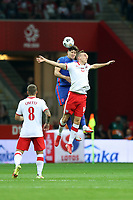 8th September 2021; PGE National Stadium, Warsaw, Poland: FIFA World Cup 2022 Football qualification, Poland versus England;  JOHN STONES challenges and wins the header from ADAM BUKSA