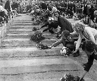 BNPS.co.uk (01202 558833)<br /> Pic: WillemienRieken/BNPS<br /> <br /> The children of Arnhem, including Willemien,  lay flowerrs at the first ceremony in 1945.<br /> <br /> As the 75th anniversary of Operation Market Garden begins tomorrow, one of the original 'flower girl''s of Arnhem is still remembering...<br /> <br /> A heartwarming tale of dedication and rememberance has been revealed over a remarkable Dutch pensioner who still tends the grave of a fallen British Arnhem hero, 75 years after he perished in battle.<br /> <br /> Every year, Willemien Rieken (84) still lays flowers at Oosterbeek War Cemetery in memory of Trooper William Edmond, who was shot by a German sniper in the early stages of Operation Market Garden in 1944.<br /> <br /> Trp Edmond, of the elite 1st Airborne Reconnaissance Squadron's final words, uttered to two comrades who came to his aid, were 'tell my wife I love her'.<br /> <br /> Willemien was just nine years old when Oosterbeek became a bloody battleground in September 1944. The retired director's secretary, now aged 84, hid in a small cellar underneath her father's confectionary shop for five days while fierce fighting raged around their house and garden.<br /> <br /> Twenty-five of her family, friends and neighbours packed into the confined space and cowered in fear in the deafening din of shooting and explosions.<br /> <br /> After the war the grateful citizens of Arnhem arranged a poignant ceremony involving a nine year old Willimein and other school children from the town, to lay flowers at the graves of the British soldiers killed in the battle. <br /> <br /> And the dedicated pensioner is now one of the last survivors to still undertake the task.