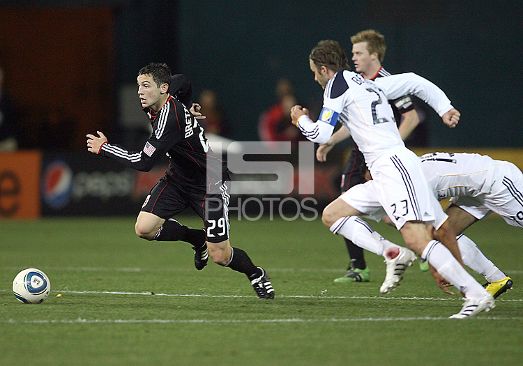 Blake Brettechneider (29) of D.C. United races away from David Beckham (23) of the Los Angeles Galaxy during an MLS match at RFK Stadium, on April 9 2011, in Washington D.C.The game ended in a 1-1 tie.