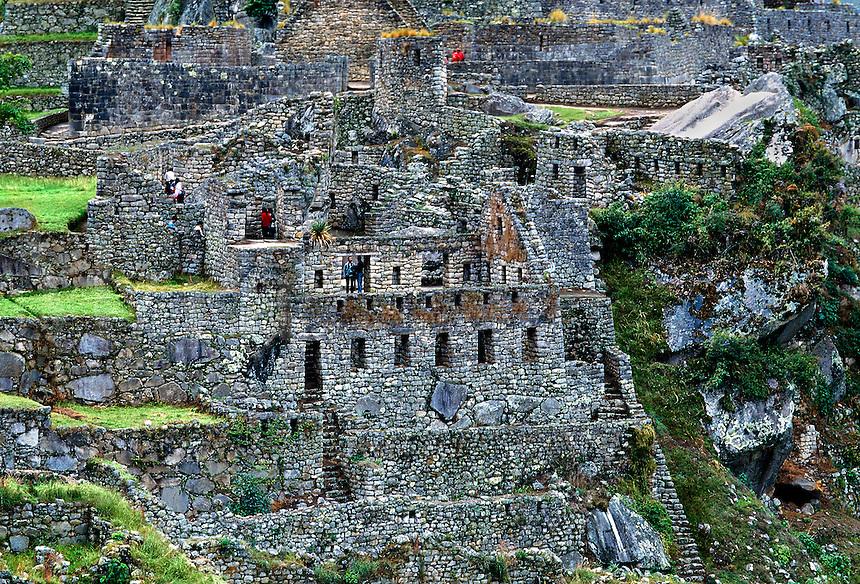 Tourists exploring the ruins at Machu Picchu in Peru.