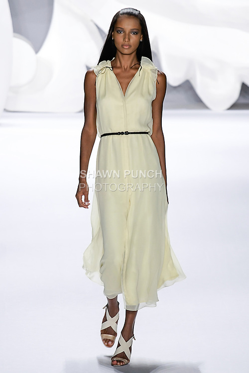 Jasmine walks runway in an outfit from the Carolina Herrera Spring 2013 Timeless Influence collection, during Mercedes-Benz Fashion Week Spring 2013 in New York City.