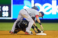 Derrik Gibson (16) of the Pawtucket Red Sox can't hold onto the baseball as Micah Johnson (3) of the Charlotte Knights steals second base at BB&T Ballpark on August 9, 2014 in Charlotte, North Carolina.  The Red Sox defeated the Knights  5-2.  (Brian Westerholt/Four Seam Images)