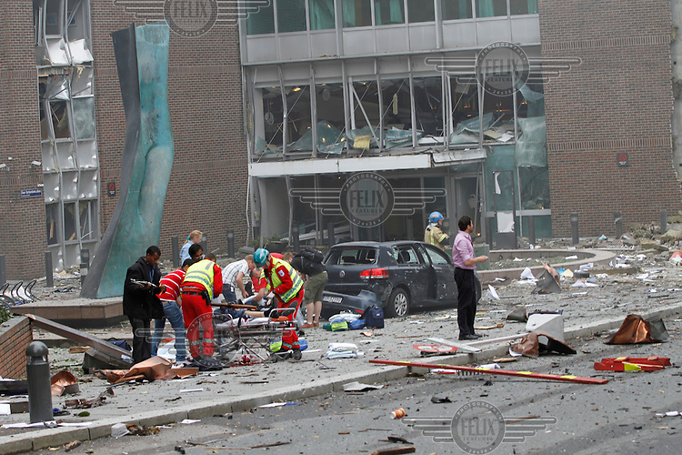 (July22,2011) A man is treated for injuries received after a large vehicle bomb was detonated near the offices of Norwegian Prime Minister Jens Stoltenberg on 22 July 2011. Although Stoltenberg was reportedly unharmed the blast resulted in several injuries and deaths. <br /> Another terrorist attack took place shortly afterwards, where a man killed over 80 children and youths attending a political camp at Utøya island. <br /> Anders Behring Breivik was arrested on the island and has admitted to carrying out both attacks.<br /> (photo:Fredrik Naumann/Felix Features)