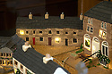 """08/12/16<br /> <br /> Hannah Bowman - new houses for local residents.<br /> <br /> In this incredibly detailed replica of a small Peak District village, everything is edible, from the baubles on the Christmas trees to the flowers around the houses and what's more the """"village"""" is made from 35 individual rich fruit Christmas cakes which will be eaten on the 25th!<br /> <br /> The amazing model village is made up of 18 shops and houses, which are all realistic reproductions of the actual buildings found in Youlgreave, and is open to the public to view at All Saints' church, the main focal point of the miniature masterpiece.<br /> <br /> Retired florist Lynn Nolan, who decorated all the cakes, came up with the original idea as a way of raising money for the church, which needs a new roof, and the first of the cakes went in the oven back in April.<br /> <br /> MORE...https://fstoppressblog.wordpress.com/the-village-thats-really-a-christmas-cake/<br /> <br /> All Rights Reserved F Stop Press Ltd. (0)1773 550665   www.fstoppress.com"""