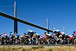 The peloton race under the Millau Viaduct during Stage 7 of Tour de France 2020, running 168km from Millau to Lavaur, France. 4th September 2020.<br /> Picture: ASO/Alex Broadway | Cyclefile<br /> All photos usage must carry mandatory copyright credit (© Cyclefile | ASO/Alex Broadway)