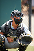 GCL Pirates catcher Manny Bejerano (58) warms up a pitcher in the bullpen during a game against the GCL Tigers West on July 17, 2017 at TigerTown in Lakeland, Florida.  GCL Tigers West defeated the GCL Pirates 7-4.  (Mike Janes/Four Seam Images)