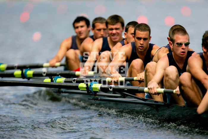 A crew rows down the river as they compete during the 68th Dad Vail Regatta on the Schuylkill River in Philadelphia, Pennsylvania on May 12, 2006.........
