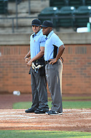 Umpires Brandon Tipton and Corbin Smith during a USA Collegiate National baseball game between Team Stars and Team Stripes on July 6, 2021 at Pioneer Park in Greeneville, Tennessee. (Tracy Proffitt/Four Seam Images)