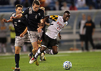 HOOVER, AL - DECEMBER 07, 2012:  Schillo Tshuma (23) of the University of Maryland gets past Joey Dillon (4) and Tyler Rudy (13) of Georgetown University during an NCAA 2012 Men's College Cup semi-final match, at Regions Park, in Hoover , AL, on Friday, December 07, 2012. The game ended in a 4-4 tie, Georgetown won on penalty kicks after overtime.