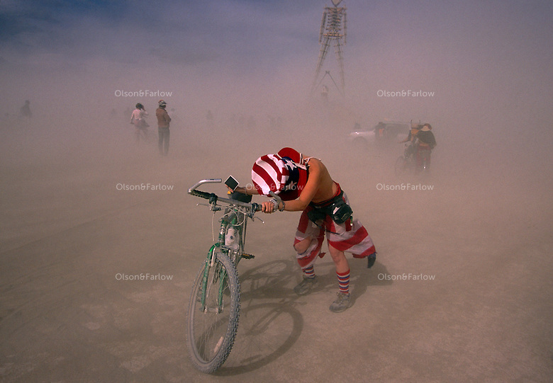 A semi-nude Uncle Sam braves a duststorm at the annual Burning Man Festival held at Black Rock Playa in northwestern Nevada's Conservation area. For the week of Burning Man, the desert becomes one of Nevada's largest cities, attracting tens of thousand of revelers celebrating a counter-culture experience.