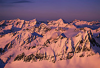 Aerial of sunset lighting in the North Cascades Mountain Range in winter, Washington State