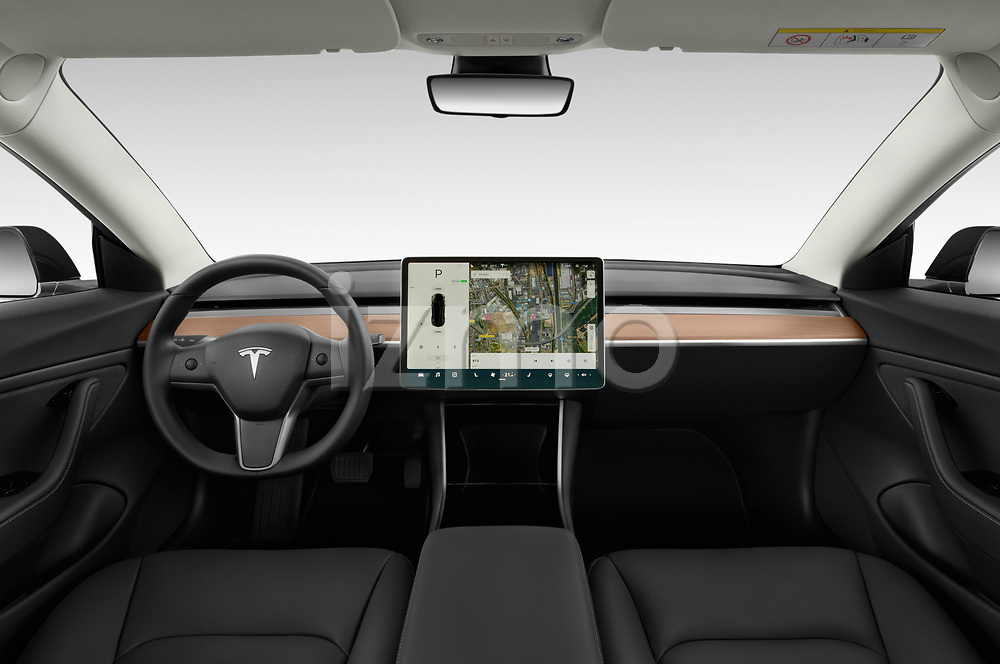 Stock photo of straight dashboard view of a 2018 Tesla Model 3 Long Range 4 Door Sedan