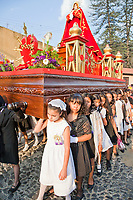 Antigua, Guatemala.  Semana Santa (Holy Week).  Young Girls Carrying an Anda (Float) of the Virgin Mary in a Religious Procession.