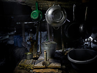 The tail of a mortar that was fired at a frontline position is displayed in the kitchen in a shelter. The position is under bombardment on a daily basis.