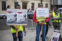 """Protestaktion """"Stoppt den Krieg gegen Migranten!"""" am Samstag den 6. Februar 2016 am ehemaligen Grenzuebergang Checkpoint Charlie in Berlin.<br /> Am 6. Februar 2014 setzte die spanische Guardia Civil Gummigeschosse und Traenengas gegen Migranten und Fluechtlinge ein, die versuchten vom marokkanischen Tarajal in die spanische Exklave Ceuta zu schwimmen. Dabei wurden 15 Menschen getoetet. Im Herbst 2015 stellte ein spanisches Gericht die Ermittlungen gegen 16 beteiligte Polizeibeamte ein, die von spanischen NGOs verklagt worden waren.<br /> Zum zweiten Jahrestag des Geschehens versammelten Fluechtlinge und Unterstuetzer am ehemaligen Grenzuebergang Checkpoint Charlie und gedachten der Toten. """"Angesichts der weiterhin dramatischen Situation der Migranten und Gefluechteten erklaeren wir insbesondere unsere Solidarität mit den Menschen aus der Subsahara, die weit entfernt von Fernsehkameras in der Wueste, sowie denen die taeglich im Mittelmeer sterben."""" so die Organisatoren der Aktion.<br /> 6.2.2016, Berlin<br /> Copyright: Christian-Ditsch.de<br /> [Inhaltsveraendernde Manipulation des Fotos nur nach ausdruecklicher Genehmigung des Fotografen. Vereinbarungen ueber Abtretung von Persoenlichkeitsrechten/Model Release der abgebildeten Person/Personen liegen nicht vor. NO MODEL RELEASE! Nur fuer Redaktionelle Zwecke. Don't publish without copyright Christian-Ditsch.de, Veroeffentlichung nur mit Fotografennennung, sowie gegen Honorar, MwSt. und Beleg. Konto: I N G - D i B a, IBAN DE58500105175400192269, BIC INGDDEFFXXX, Kontakt: post@christian-ditsch.de<br /> Bei der Bearbeitung der Dateiinformationen darf die Urheberkennzeichnung in den EXIF- und  IPTC-Daten nicht entfernt werden, diese sind in digitalen Medien nach §95c UrhG rechtlich geschuetzt. Der Urhebervermerk wird gemaess §13 UrhG verlangt.]"""