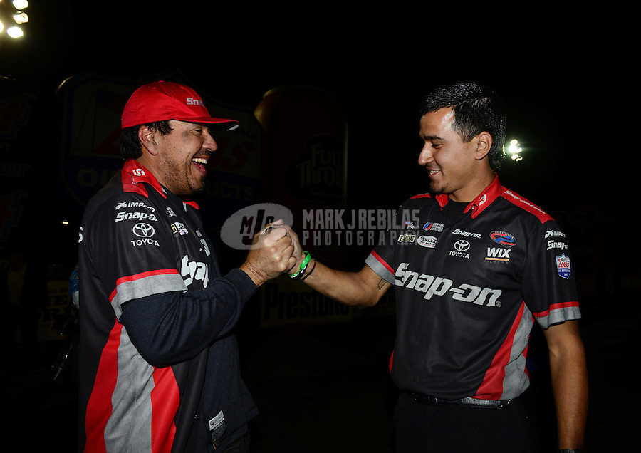 Nov. 11, 2012; Pomona, CA, USA: NHRA funny car driver Cruz Pedregon celebrates with crew members after winning the Auto Club Finals at at Auto Club Raceway at Pomona. Mandatory Credit: Mark J. Rebilas-