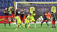 NASHVILLE, TN - SEPTEMBER 23: Anibal Godoy #20 of Nashville SC sends his free kick over Russell Canouse #4 of DC United during a game between D.C. United and Nashville SC at Nissan Stadium on September 23, 2020 in Nashville, Tennessee.