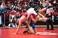 STANFORD, CA - March 7, 2020: Dylan Johnson of Little Rock and Josh Annis of Cal State Bakersfield during the 2020 Pac-12 Wrestling Championships at Maples Pavilion.