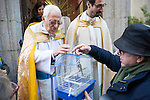 A bird is blessed by Padre Angel at San Anton church in Madrid marking San Anton Abad's Day (Saint Anthony), on January 17, 2016. Pet animals, many dressed in their finest, trooped into churches across Spain in search of blessing on the patron saint of animals Saint Anthony's Day.  (ALTERPHOTOS/Rodrigo Jimenez)
