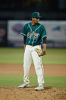 Greensboro Grasshoppers relief pitcher Oliver Garcia (37) looks to his catcher for the sign against the Winston-Salem Dash at First National Bank Field on June 3, 2021 in Greensboro, North Carolina. (Brian Westerholt/Four Seam Images)