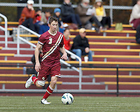 Boston College defender Ryan Dunn (3) dribbles,Boston College (maroon) defeated Virginia Tech (Virginia Polytechnic Institute and State University) (white), 3-1, at Newton Campus Field, on November 3, 2013.
