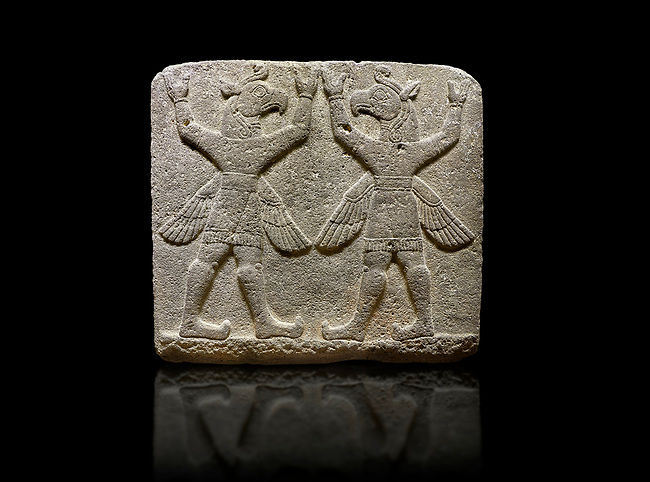 """Photo of Hittite relief sculpted orthostat stone panel of Herald's Wall Basalt, Karkamıs, (Kargamıs), Carchemish (Karkemish), 900-700 B.C. Bird-headed, winged figures of human body. Anatolian Civilisations Museum, Ankara, Turkey.<br /> <br /> These figures are called as """"Winged Griffin Demons"""". Embossing is constructed symmetrically. Their hands are on their heads. It is assumed that they carry the heavens. <br /> <br /> Against a black background."""