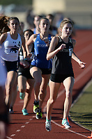 Emily Robinson (right) of Bentonville leads the field Friday, April 30, 2021, in the 1,600 meters during the 6A-West Conference Track and Field Meet at the Tiger Athletic Complex in Bentonville. Visit nwaonline.com/210501Daily/ for today's photo gallery. <br /> (NWA Democrat-Gazette/Andy Shupe)
