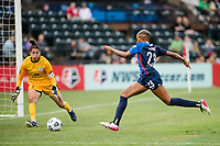 TACOMA, WA - JULY 31: Tziarra King #23 of the OL Reign chases the ball during a game between Racing Louisville FC and OL Reign at Cheney Stadium on July 31, 2021 in Tacoma, Washington.