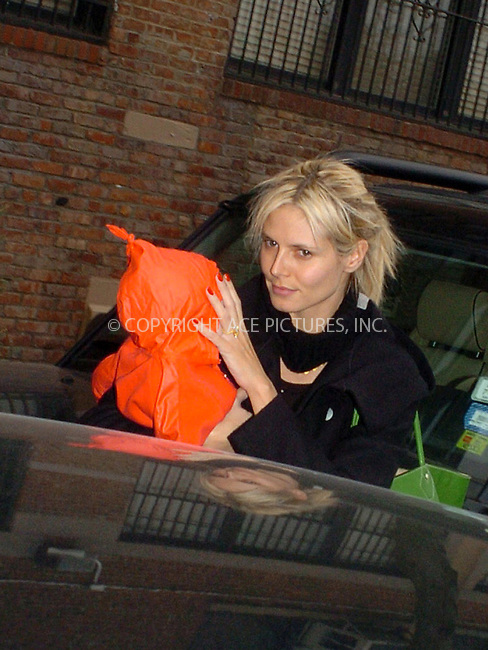 WWW.ACEPIXS.COM . . . . .  ....NEW YORK, MARCH 25, 2005....Heidi Klum heads out of her West Village home with little baby Leni.....Please byline: Philip Vaughan -- ACE PICTURES.... *** ***..Ace Pictures, Inc:  ..Craig Ashby (212) 243-8787..e-mail: picturedesk@acepixs.com..web: http://www.acepixs.com