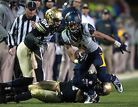 Kenny Lawler of California runs the ball during the game against Colorado at Folsom Field in Boulder, Colorado on November 16th, 2013.  Colorado defeated California, 41-24.