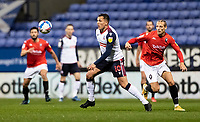 Bolton Wanderers' Antoni Sarcevic (centre) breaks away from Salford City's Oscar Threlkeld<br /> <br /> Photographer Andrew Kearns/CameraSport<br /> <br /> The EFL Sky Bet League Two - Bolton Wanderers v Salford City - Friday 13th November 2020 - University of Bolton Stadium - Bolton<br /> <br /> World Copyright © 2020 CameraSport. All rights reserved. 43 Linden Ave. Countesthorpe. Leicester. England. LE8 5PG - Tel: +44 (0) 116 277 4147 - admin@camerasport.com - www.camerasport.com