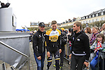 Team Lotto NL-Jumbo directors lead Sep Vanmarcke (BEL) away for spending too long with the fans at the Team Presentations in Compiegne before the 2015 Paris-Roubaix cycle race held over the cobbled roads of Northern France. 11th April 2015.<br /> Photo: Eoin Clarke www.newsfile.ie