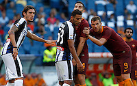 Calcio, Serie A: Roma vs Udinese. Roma, stadio Olimpico, 20 agosto 2016.<br /> Roma's Kostas Manolas, second from right, and Roma's Edin Dzeko, right, face Udinese's Gabriele Angella, left, and Kadhim Ali Adnan, during the Italian Serie A football match between Roma and Udinese at Rome's Olympic Stadium, 20 August 2016. Roma won 4-0.<br /> UPDATE IMAGES PRESS/Riccardo De Luca