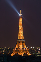 Eiffel Tower with rotating beacon at night, Paris, France