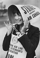 Keeping dry: Sheila Burns uses a picket sign to protect her from the rain yesterday as striking Air Canada flight attendants protested at Pearson International Airport.<br /> <br /> Photo : Boris Spremo - Toronto Star archives - AQP
