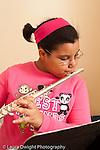 Education K-8 public school third grade girl playing the flute