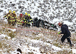 Carson City Fire personnel rescue a 40-year-old man who was injured after his truck rolled 400 feet off Goni Road in Carson City, Nev., on Wednesday, Jan. 6, 2016.  <br /> Photo by Cathleen Allison/Nevada Photo Source