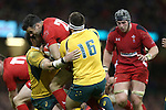 Wales replacement scrum half Michael Phillips crashes into Australia pair James Hanson and Ben McCalman.<br /> Dove Men Series 2014<br /> Wales v Australia<br /> Millennium Stadium<br /> 08.11.14<br /> ©Steve Pope-SPORTINGWALES