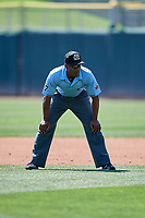 First base umpire Malachi Moore handles the calls on the bases during a game between the Salt Lake Bees and the Fresno Grizzlies at Smith's Ballpark on September 3, 2018 in Salt Lake City, Utah. The Grizzlies defeated the Bees 7-6. (Stephen Smith/Four Seam Images)