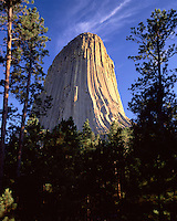 Devils Tower glows in the setting sun light.