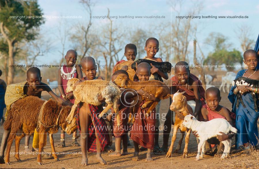 TANSANIA Handeni, Massai Kinder mit Ziegen in einem Kraal in der Maassai Steppe / TANZANIA Massai children with goat in Kraal