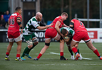 Rayn Smid of Ealing Trailfinders is tackled by Liam Hallam-Eames (left) and Roy Godfrey of Jersey Reds during the Championship Cup Quarter final match between Ealing Trailfinders and Jersey Reds at Castle Bar , West Ealing , England  on 22 February 2020. Photo by Alan  Stanford / PRiME Media Images.