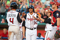 Lansing Lugnuts pinch runner Josh Almonte (26) and Chris Carlson (3)  congratulate Tim Locastro (4) after hitting a home run during a game against the Peoria Chiefs on June 6, 2015 at Cooley Law School Stadium in Lansing, Michigan.  Lansing defeated Peoria 6-2.  (Mike Janes/Four Seam Images)