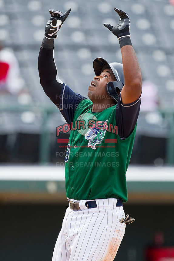 Gookie Dawkins #9 of the Charlotte Knights points to the sky after touching home plate following his 100th career minor league home run in the game against the Syracuse Chiefs at Knights Stadium on June 19, 2011 in Fort Mill, South Carolina.  The Knights defeated the Chiefs 10-9.    (Brian Westerholt / Four Seam Images)