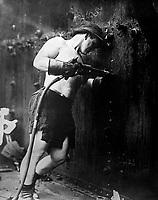 Riveter at work at Hog Island Shipyard.  Pennsylvania, 1918.  Kadel & Herbert. (War Dept.)<br /> Exact Date Shot Unknown<br /> NARA FILE #:  165-WW-509B-4<br /> WAR & CONFLICT BOOK #:  534