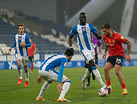 7th November 2020 The John Smiths Stadium, Huddersfield, Yorkshire, England; English Football League Championship Football, Huddersfield Town versus Luton Town; George Moncur of Luton Town being defended by Pipa of Huddersfield Town and Mouhamadou-Naby Sarr of Huddersfield Town