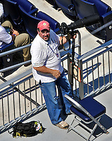 23 August 2009: Photographer Mark Goldman prepares to shoot from the stands during a game between the Washington Nationals and the Milwaukee Brewers at Nationals Park in Washington, DC. The Nationals defeated the Brewers 8-3 to take the third game of their four-game series, snapping a five games losing streak. Mandatory Credit: Ed Wolfstein Photo