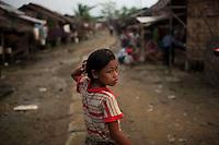 A child walks through the Hlaing Thaya slum district of Yangon.