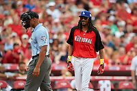 Rapper Snoop Dogg talks with umpire JJ January during the All-Star Legends and Celebrity Softball Game on July 12, 2015 at Great American Ball Park in Cincinnati, Ohio.  (Mike Janes/Four Seam Images)